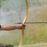 21810849 - archery man shooting arrow with bow in the nature
