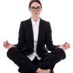 60020660 - relaxation concept - young beautiful business woman sitting in yoga pose isolated on white background
